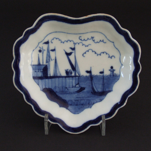 A Blue and White Daoguang Porcelain Plate Decorated with the Eight Immortals Standing on Clouds.