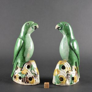 A Pair of Kangxi or Yongzheng Biscuit Porcelain Parrots