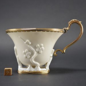 Large 17th Century Blanc de Chine Porcelain cup, Dehua kilns, Fujian Province c.1640 - 1680. One side with applied prunus decoration, the other is of magnolia. The European ormolu mount is of good quality and probably dates to the early 18th Century.